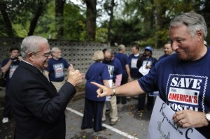 Rep. Gerald Connolly, left, talks with Ernie Kirkland of NALC at a rally in Annandale, Va.