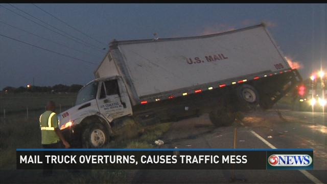 Video: Mail Truck Overturns, Causes Traffic Mess