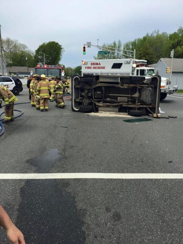 New Jersey firefighters free trapped letter carrier from flipped mail truck