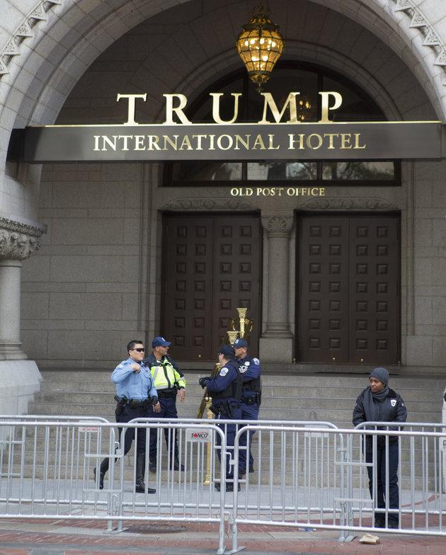 A double layer of security barricades surround the front of Trump International Hotel in downtown Washington, Tuesday, Nov. 15, 2016, as police stand watch. (AP Photo/Jon Elswick)